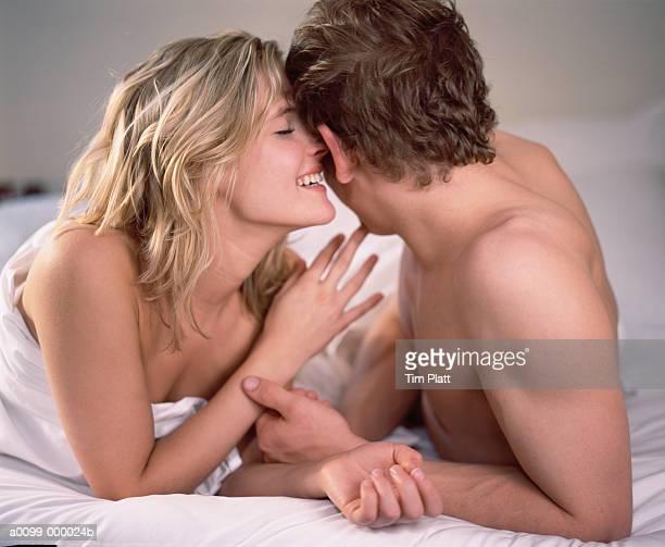 Girl Whispering in Man's Ear