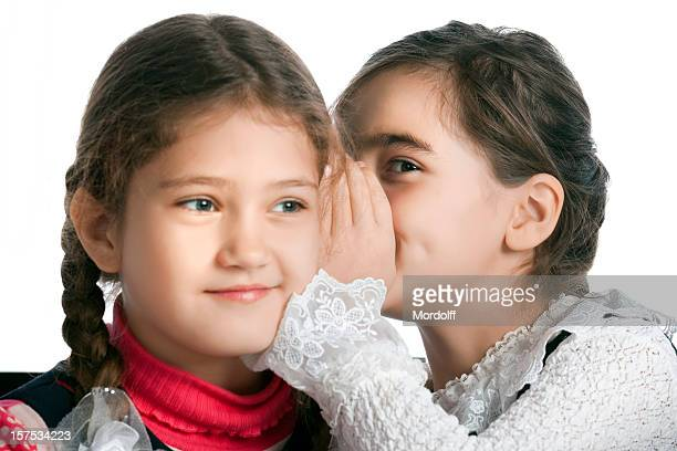 Girl whispering the secret with her friend
