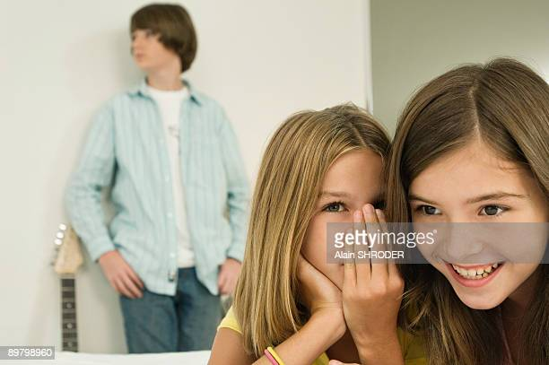 Girl whispering to her sister