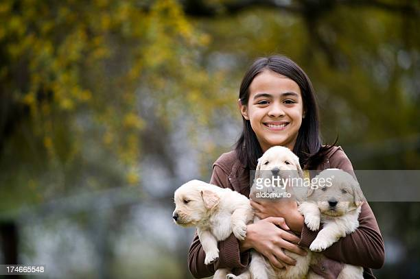 Girl whit three puppies