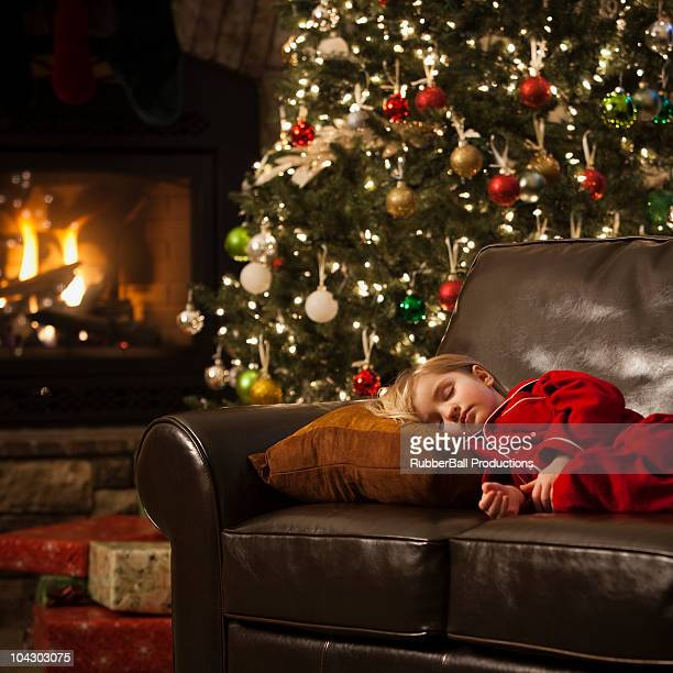 girl who fell asleep on the couch waiting for santa - orem utah stock pictures, royalty-free photos & images