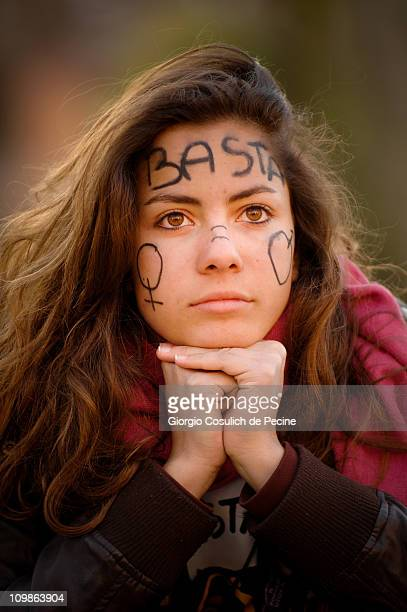 A girl who has written on his forehead 'enough' takes part in the demonstration organized by women's national movement 'If not now when' on the...