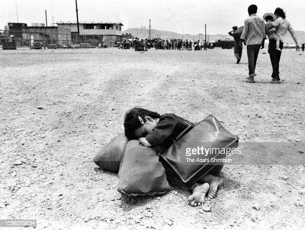 A girl who lost her parents sleep on the street on arrival at Vung Tau as the northern forces take Da Nang and Cam Ranh during the Vietnam War on...