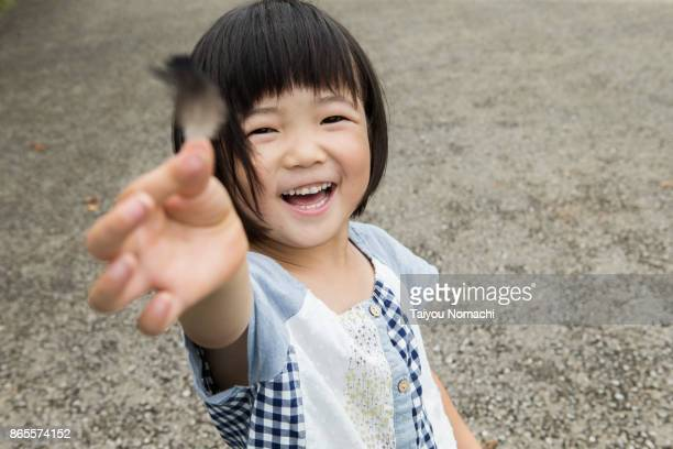 Girl who picked up feathers