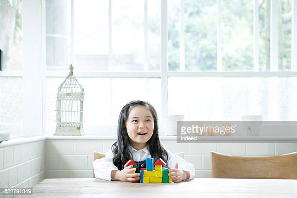 A girl who play with building blocks