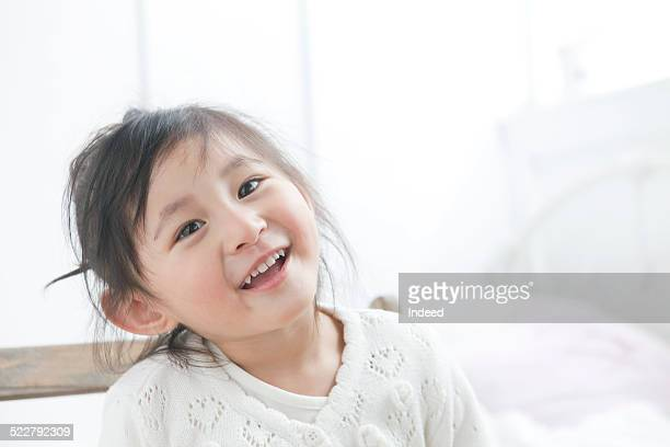 a girl who smiles - the slants stock pictures, royalty-free photos & images