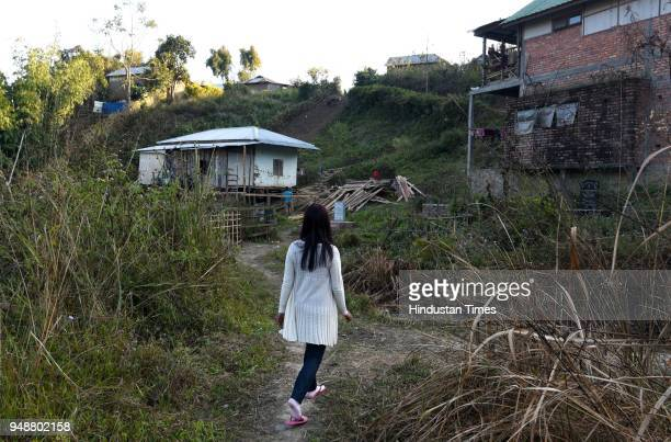 A girl who was a victim of trafficking and identity theft outside her home at Churachandpur on January 22 2018 some 200 Km from Imphal India...
