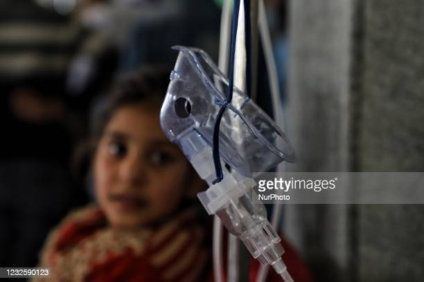 Girl who was put on ventilator after tested Positive for COVID-19 looks towards the Oxygen mask after she received Oxygen support at a COVID-19...