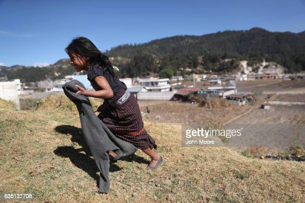 A girl who's father works as as immigrant laborer in the US plays in Cajola on February 11 2017 in the western highlands of Guatemala Women are...