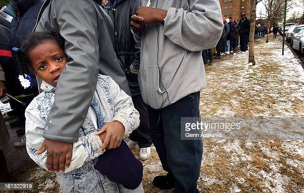 DENVER COLORADO DECEMBER 22 2003A girl whose mother asked that she not be identified by name waits in line with her family for a $2000 cash gift...