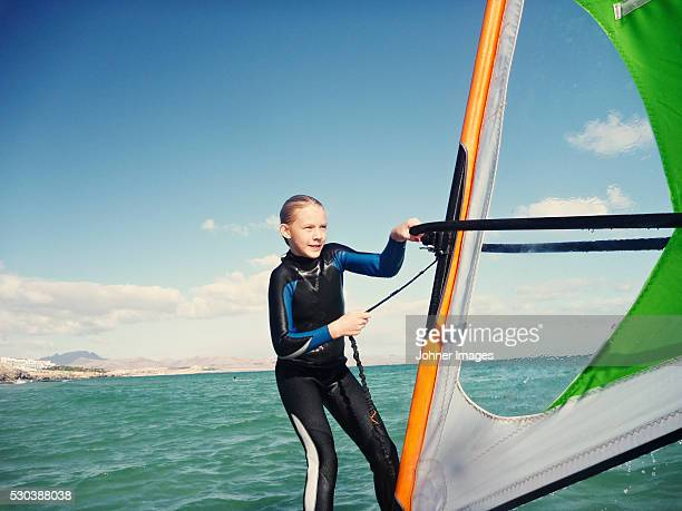 girl windsurfing - windsurfing stock pictures, royalty-free photos & images
