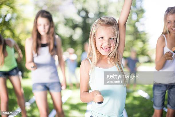 Girl winning in an egg-and-spoon race
