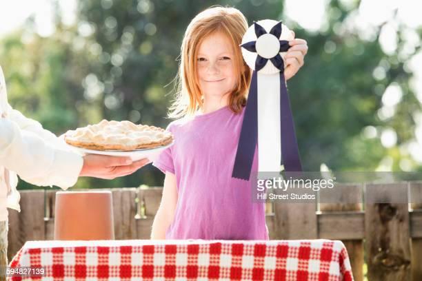 Girl winning pie baking contest