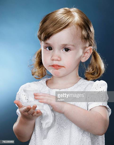 Girl (1-3) wiping hands with tissue, portrait
