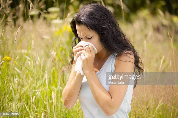 girl wiping nose with tissue - allergies stock photos and pictures