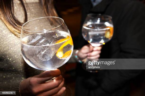 girl with 2 gin tonics - tonic water stock pictures, royalty-free photos & images