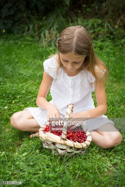 girl with a basket of freshly picked currants