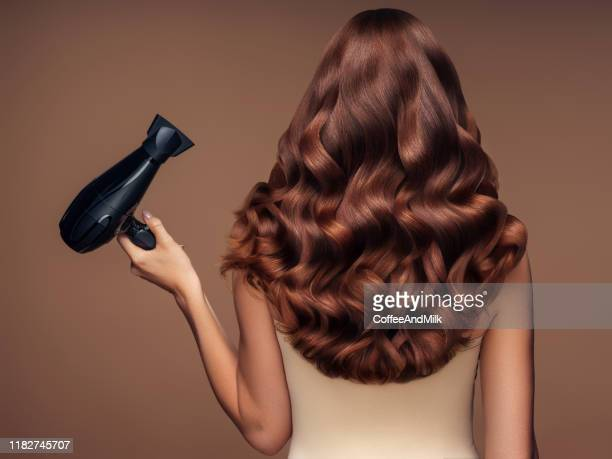 girl with a beautiful hairstyle holding a hairdryer - fashion model stock pictures, royalty-free photos & images