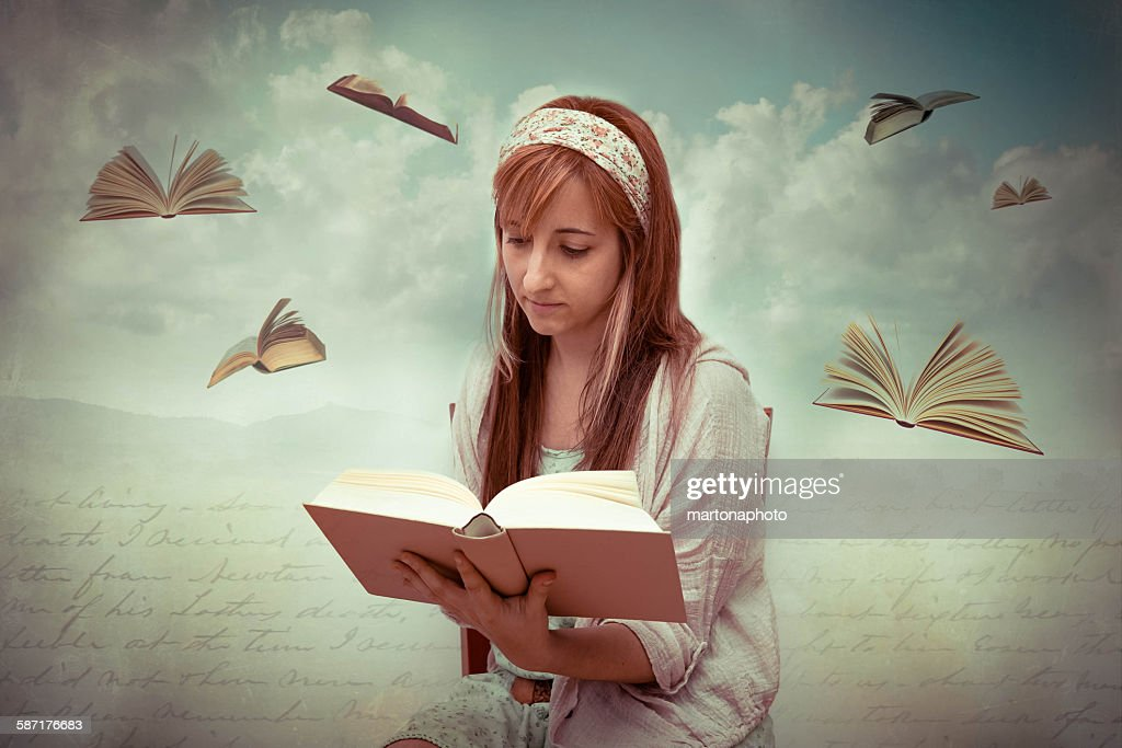 Girl with a book in hands : Foto de stock
