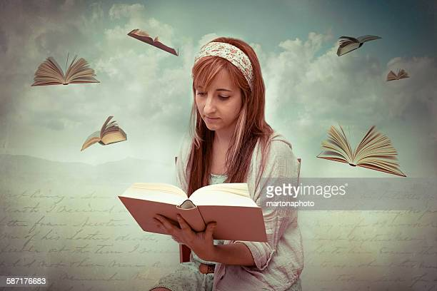 Girl with a book in hands