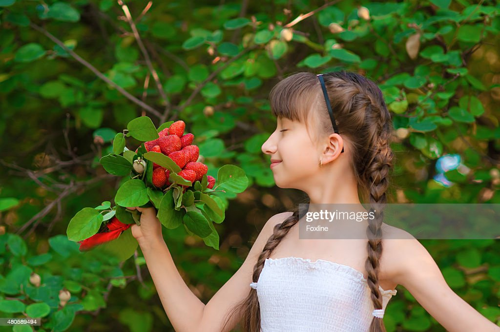 Girl with a bouquet of strawberries : Stock Photo