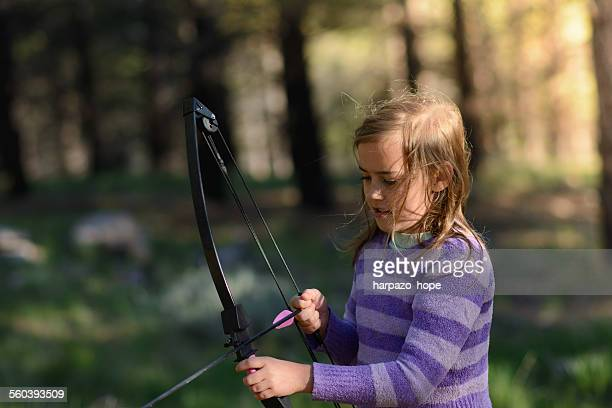Girl with a bow and arrow.