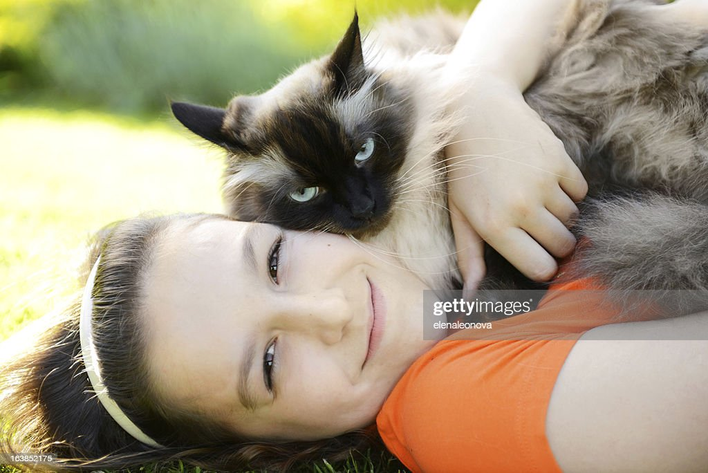 Girl with a cat : Stock Photo
