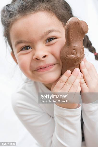 Girl with a chocolate Easter Bunny