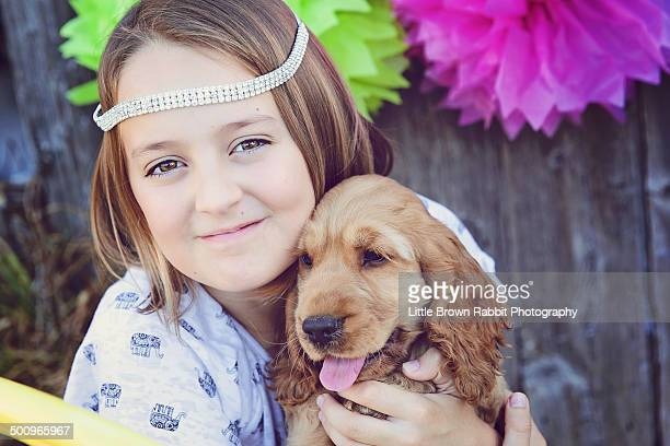 Girl With a Cocker Spaniel Puppy