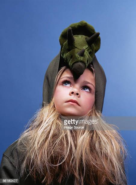 Girl with a dinosaur toy on her head