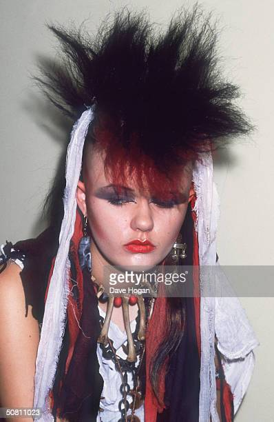 A girl with a dyed punk hairstyle and a bone necklace 1983