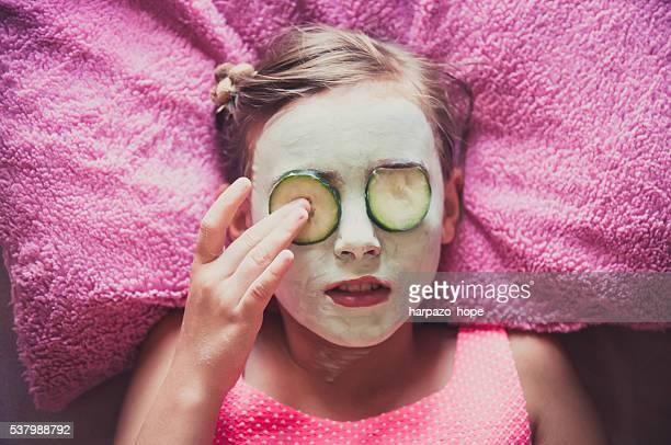 Girl with a facial mask.