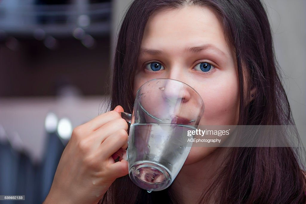 Girl with a glass of water : Stock Photo