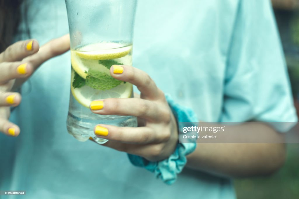 girl with a glass of water with lemon and mint : Stock Photo