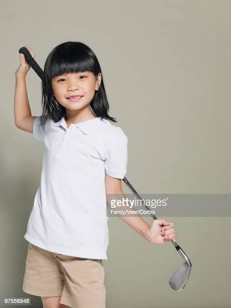 Girl with a golf club