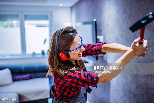 girl with a hammer - demolishing stock pictures, royalty-free photos & images