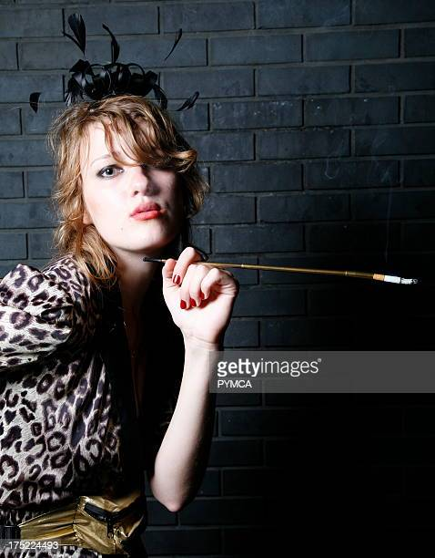 A girl with a long cigarette holder Outside Boombox Hoxton Bar and Kitchen Shoreditch London 2007
