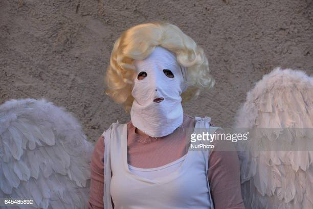 A girl with a Mask in Luzon´s Carnival during an ancient Carnival in Guadalajara Spain on 25 February 2017 The Devils of Luzón that carry antlers of...