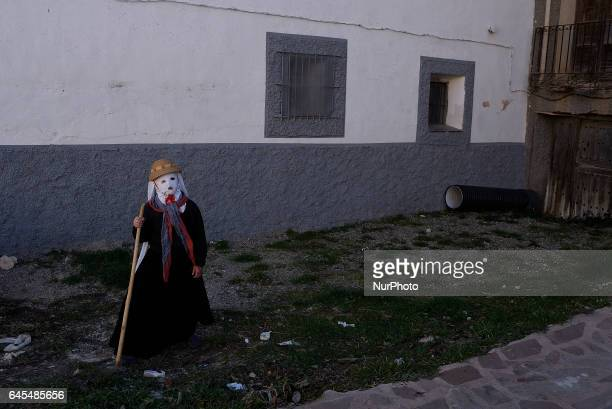 A girl with a mask know as `Mascarita´during an ancient Carnival in Guadalajara Spain on 25 February 2017 The Devils of Luzón that carry antlers of...