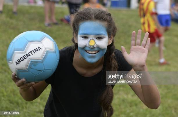 A girl with a painted face poses as she attends a party organized by the town of Bronnitsy where the Argentina football team have their base camp...