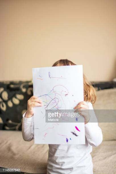 girl with a picture - innocence stock pictures, royalty-free photos & images