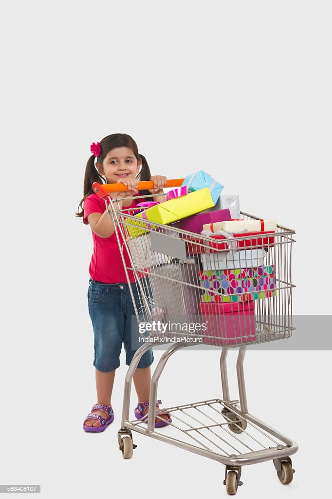 Girl with a shopping cart : Stock Photo