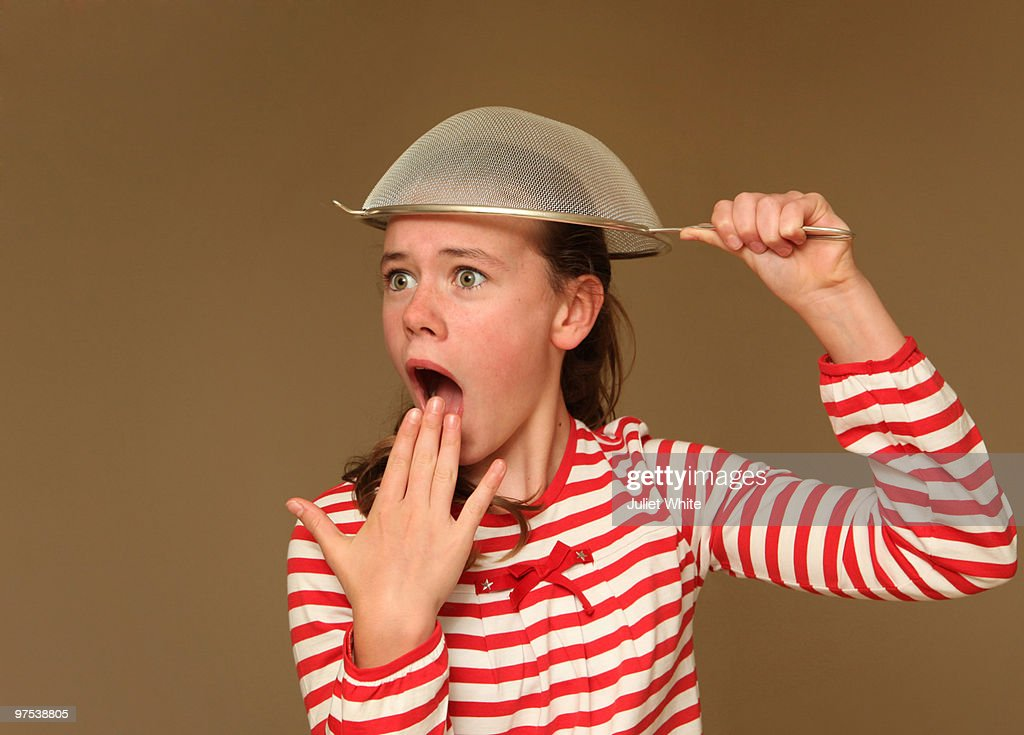 Girl with a Sieve on her Head : Stock Photo