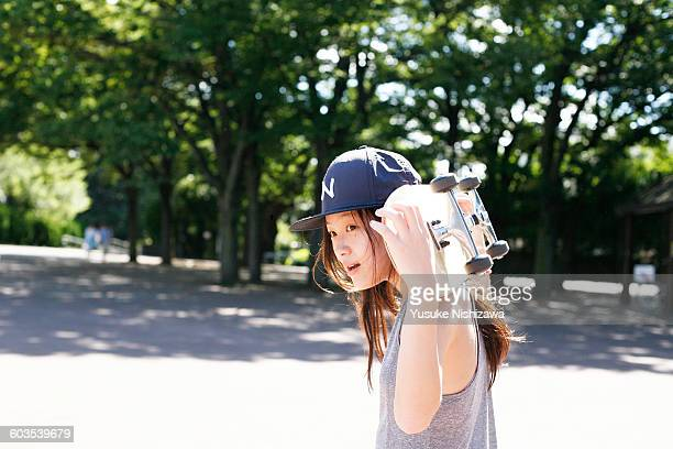 girl with a skateboard - yusuke nishizawa stock pictures, royalty-free photos & images