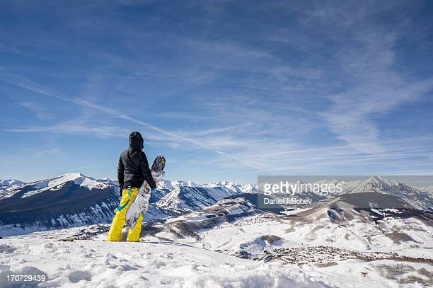 girl with a snowboard, high in the mountains. - aspen colorado stock photos and pictures