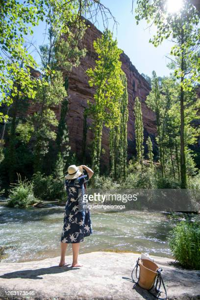 girl with a straw hat taking a photography - spain stock pictures, royalty-free photos & images