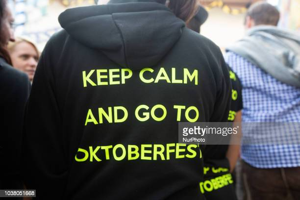 A girl with a swetshirt saying 'Keep calm and go to the Oktoberfest' on day one of the Oktoberfest ceebrations in Munich Germany on 22 September 2018...