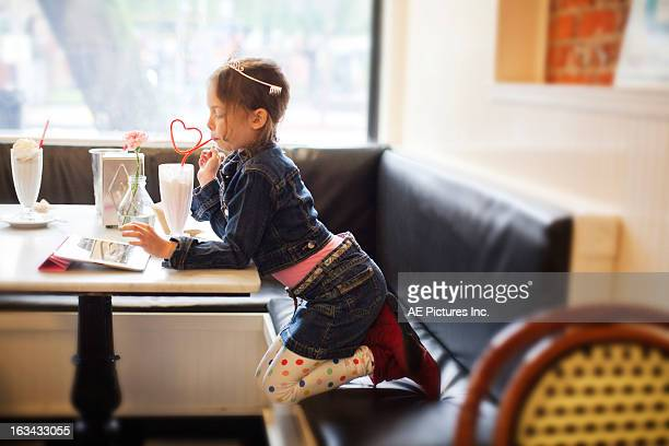 girl with a tablet and milkshake - girls with short skirts stock photos and pictures