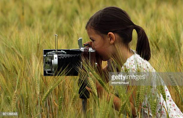 girl with a vintage camera - child prodigy stock pictures, royalty-free photos & images