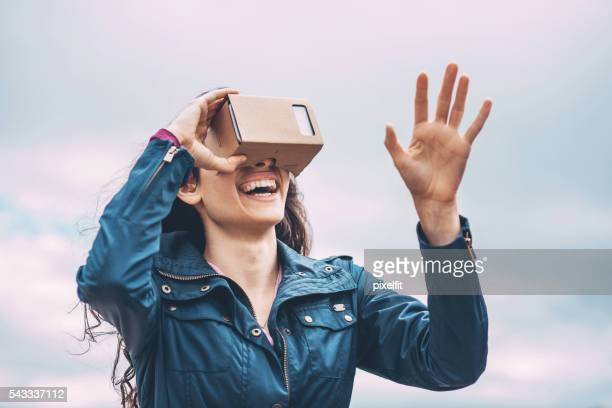 Girl with a virtual reality simulator